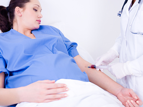 Pregnant woman having injection