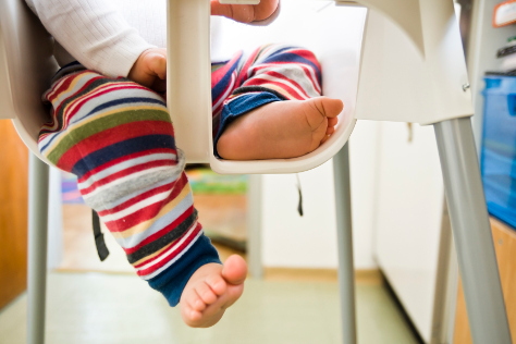 Baby feet in highchair