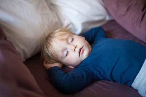toddler asleep on sofa
