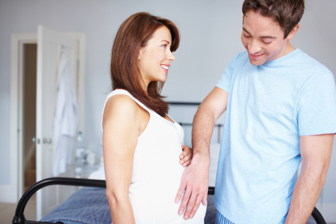 Dad touching pregnancy bump
