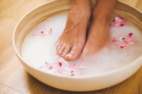 Pregnant woman soaking feet