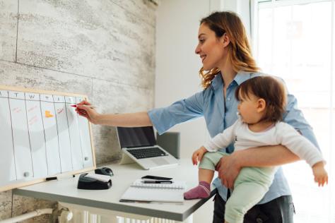 Mum multi tasking with baby