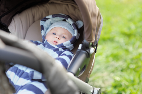 11 week old baby in pram in the park