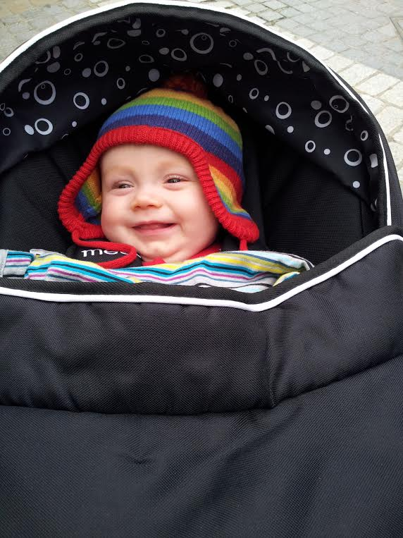 Image baby wrapped up warm outside in winter