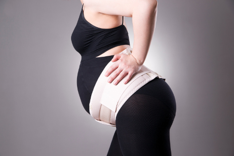 Pregnant woman with maternity belt