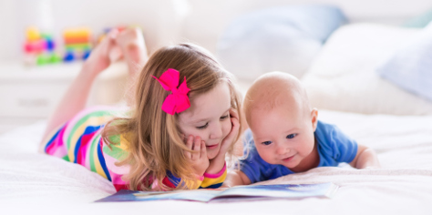 Toddler girl with baby brother