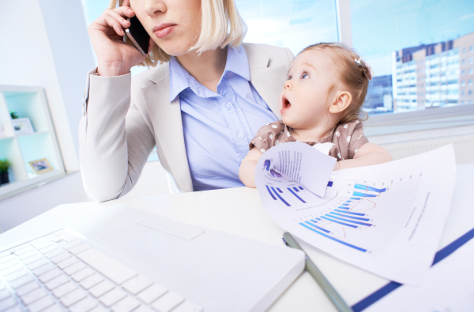 Mum on phone in office with baby