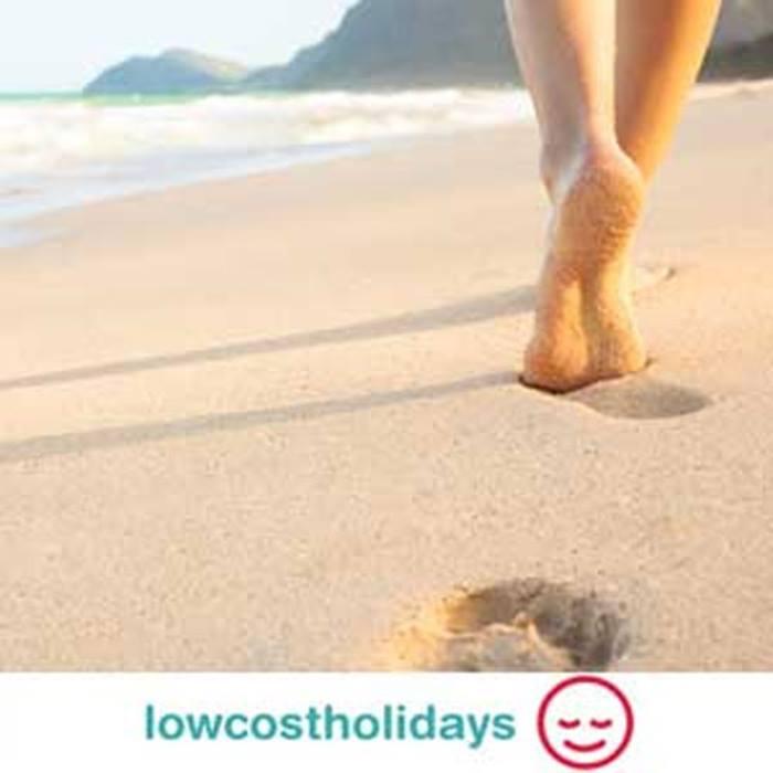 cheap-holidays-with-lowcostholidayscomlowcostholiday_feetinsand.jpg