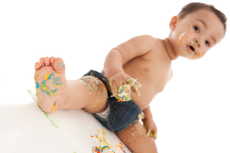 Baby covered in cake