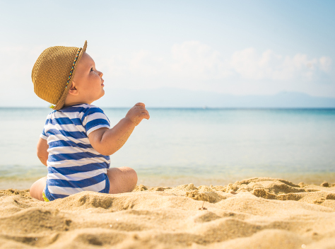 baby on the beach in the sun