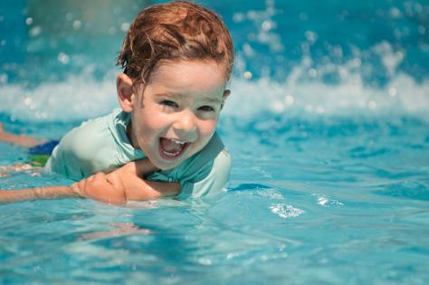 Toddler boy in pool