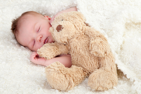 Baby asleep with teddy bear