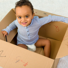 Toddler in a cardboard box