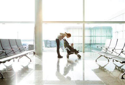 Mum with baby in buggy at airport