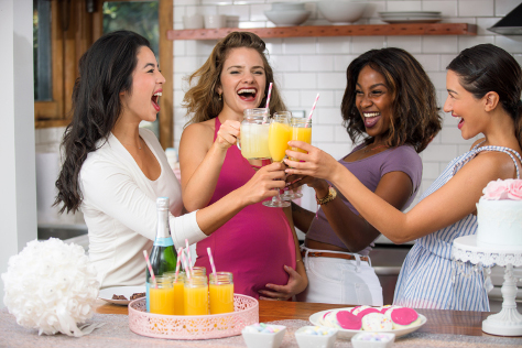pregnant woman with friends and mocktail