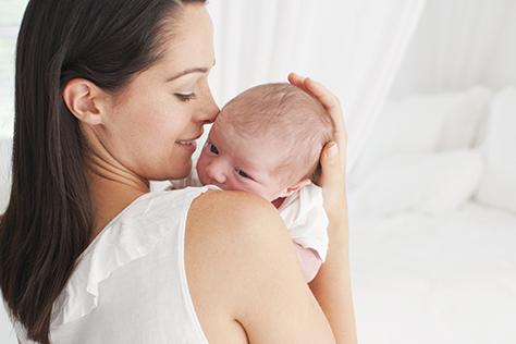 mother cudding baby-474