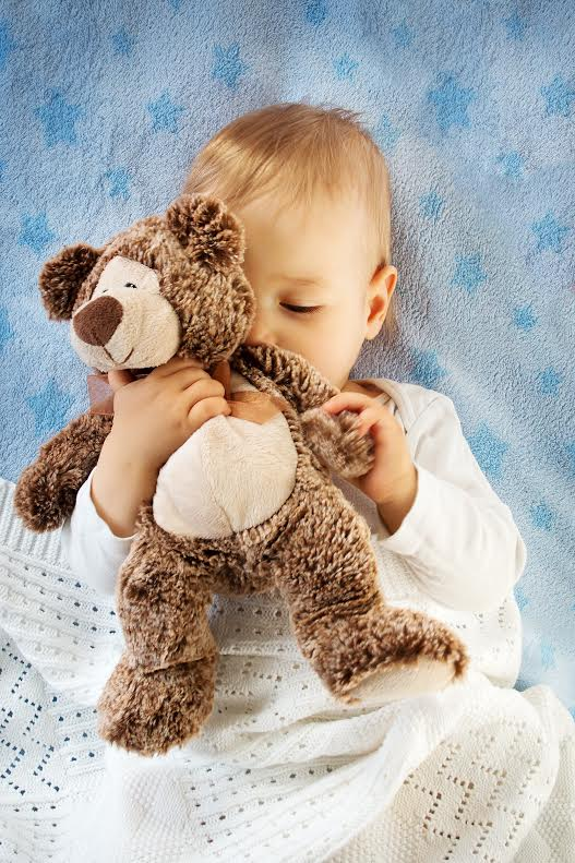 Image baby with toy stimulating sense of smell
